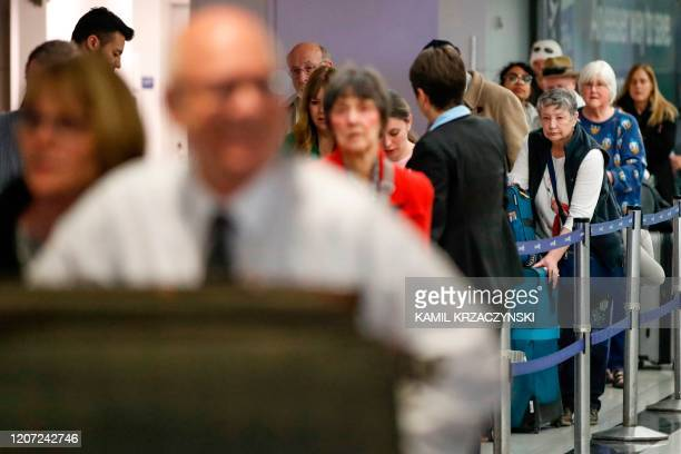 Travelers arrive at the international terminal of the O'Hare Airport in Chicago Illinois on March 15 2020 Chaos gripped major US airports Sunday as...