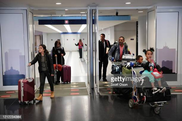 Travelers arrive in the international terminal at O'Hare Airport on March 13, 2020 in Chicago, Illinois. Today was the last day for travelers from 26...