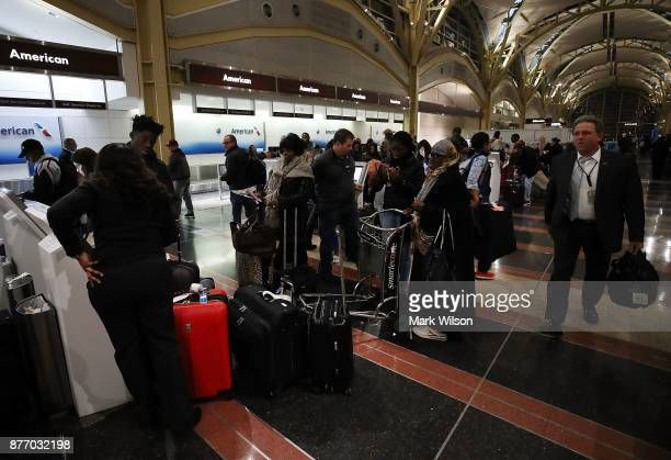 Travelers arrive to check in at Reagan National Airport on November 21 2017 in Arlington Virginia Heavy air travel is expected for this Thanksgiving...