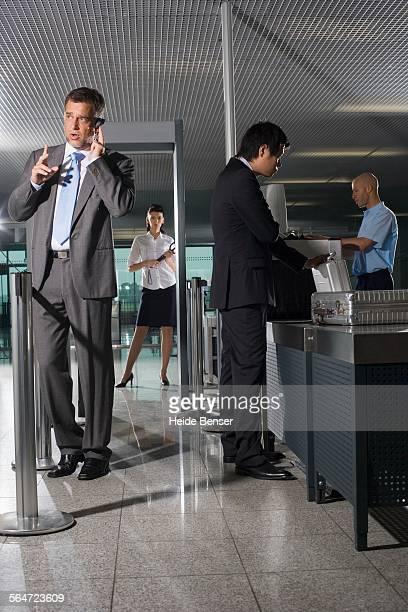 Travelers at Airport Security