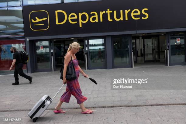 Travelers at Gatwick Airport on July 30, 2021 in London, England. Restrictions to and from the UK remain in place as Coronavirus continues to disrupt...