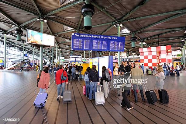 travelers at schiphol railway station in the netherlands - schiphol airport stock photos and pictures