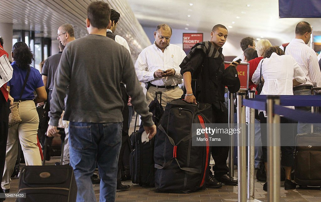 Travelers at the ticket counter before boarding flights at