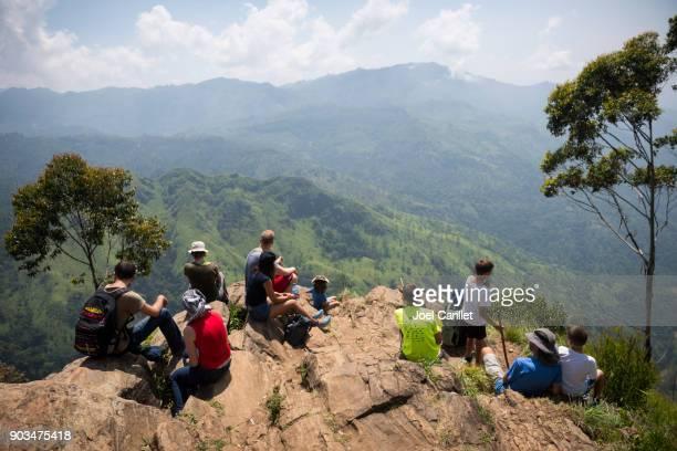 Travelers at the top of Ella Rock in Ella, Sri Lanka