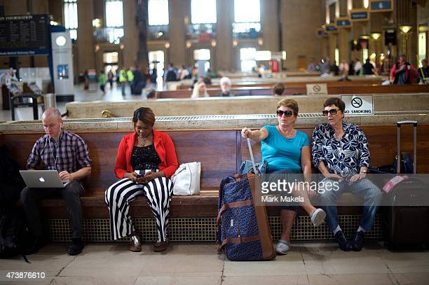 Travelers await their trains while Amtrak resumed northbound service from 30th Street Station with a 553am departing train after last week's...