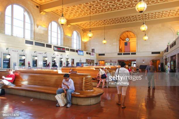travelers bustling through newhaven train station - ivy league university stock pictures, royalty-free photos & images