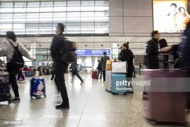 Travelers carry their luggage through the main hall of the Shanghai Hongqiao Railway Station in Shanghai China on Wednesday Jan 30 2019 Chinese New...