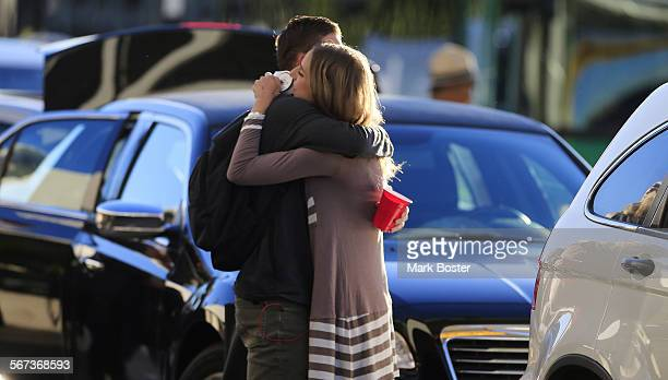 Travelers catching flights at LAX get one last hug outside Terminal One on getaway day the day before Thanksgiving Wednesday November 26 2014 More...