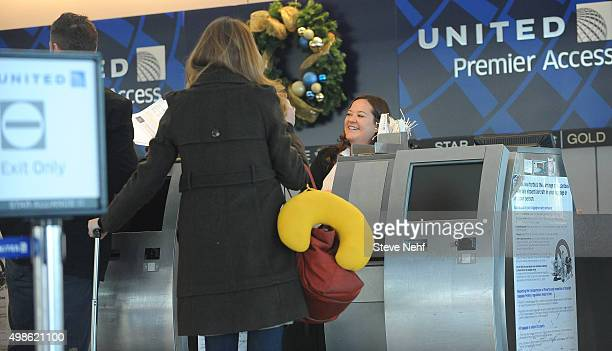 Travelers check in at the United Airlines ticket counter Tuesday morning at Denver International Airport The main terminal was relatively busy even...