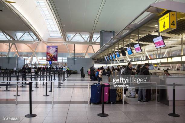 Travelers check in for a flight at John F Kennedy International Airport during Winter Storm Quinn in New York US on Wednesday March 7 2018 New York...