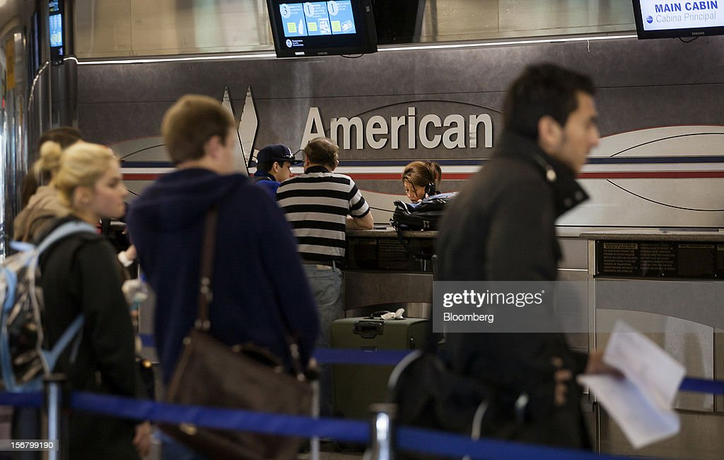 Travelers check in for flights at the American Airlines Inc. counter at LaGuardia Airport in the Queens borough of New York, U.S., on Wednesday, Nov. 21, 2012. U.S. travel during the Thanksgiving holiday weekend will rise a fourth straight year, gaining 0.7 percent from 2011, as trips by automobile rise even as airplane trips decline, AAA said last week. Photographer: Michael Nagle/Bloomberg via Getty Images