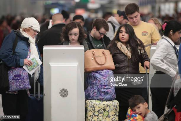 Travelers check in for their flights at O'Hare Airport on November 21 2017 in Chicago Illinois Nearly 2 million travelers are expected to pass...