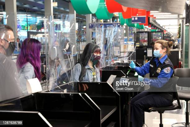 Travelers check in with TSA at O'Hare International Airport on November 25, 2020 in Chicago, Illinois. Although airports are expecting fewer than...