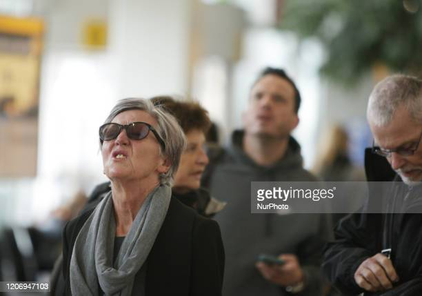 Travelers check the flight information on the departures screen at the Schiphol Airport on March 13, 2020 in Amsterdam,Netherlands. President Donald...
