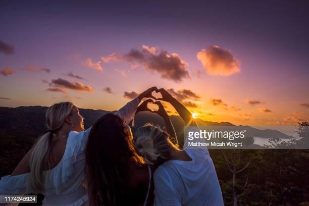 travelers climb atop a building to watch the sunset. - townsville australia fotografías e imágenes de stock