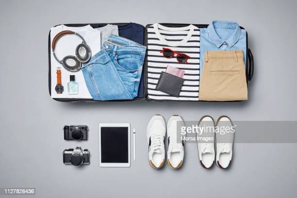 traveler's clothes and accessories - silver shoe stock photos and pictures