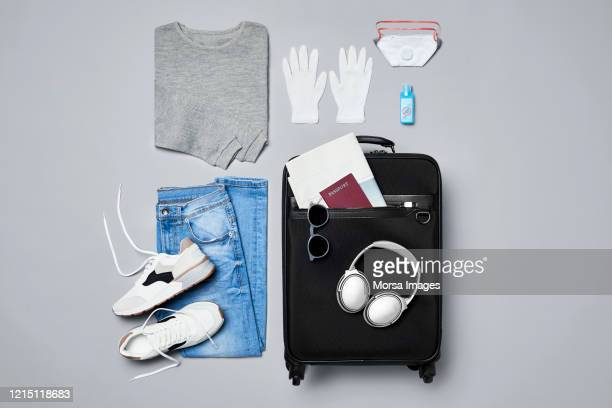 traveler's clothes and personal safety travel accessories against covid-19 - travel stock pictures, royalty-free photos & images
