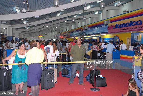 Travelers crowd Sangster International airprort near Montego Bay Jamaica 20 August after the airport reopened following the passage of hurrican Dean...