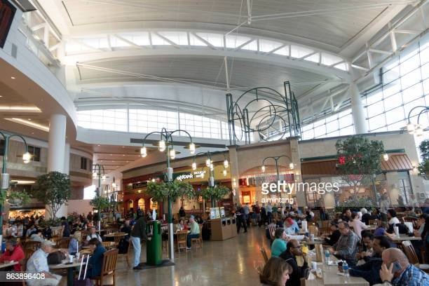 Travelers dining at food court in Seattle-Tacoma International Airport