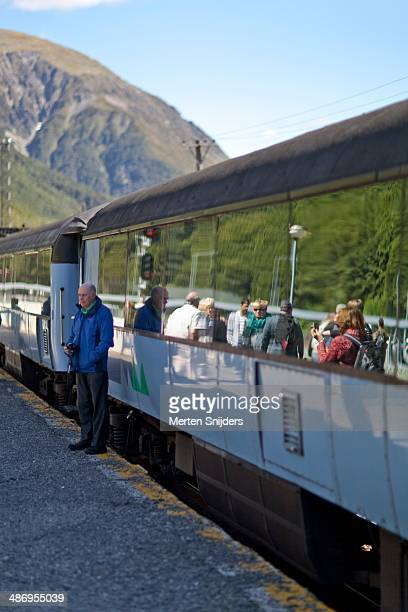 Travelers disembarked the tranz alpine train for a break and photo opportunity at Arthurs Pass.