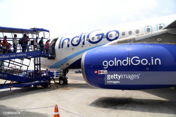 travelers entering an airplane ready for departure at airport, india - navy blue stock pictures, royalty-free photos & images