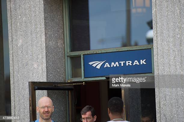 Travelers exit 30th Street Station where Amtrak resumed northbound service with a 553am departing train after last week's derailment on May 18 2015...