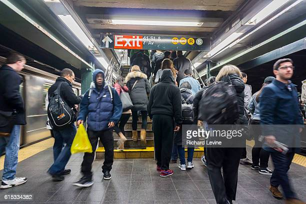 Travelers exit the Times Square subway station in New York on Saturday March 19 2016