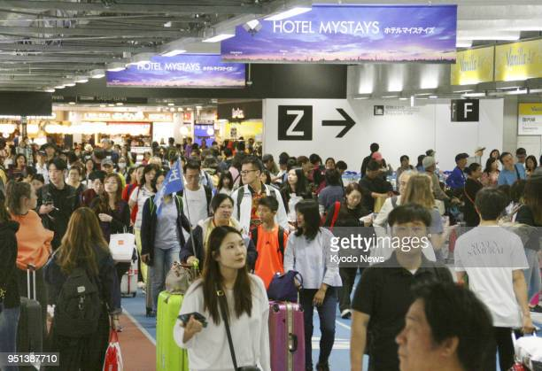 Travelers fill Narita airport's Terminal 3 in Chiba Prefecture east of Tokyo on April 21 2018 The terminal used by budget airlines will be expanded...