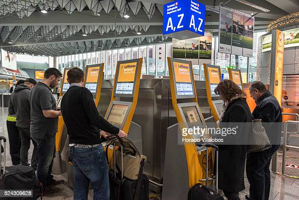 Travelers get boarding passes at Lufthansa dispensers in Terminal 1 of Frankfurt International Airport in Frankfurt Germany 06 November 2015 on the...