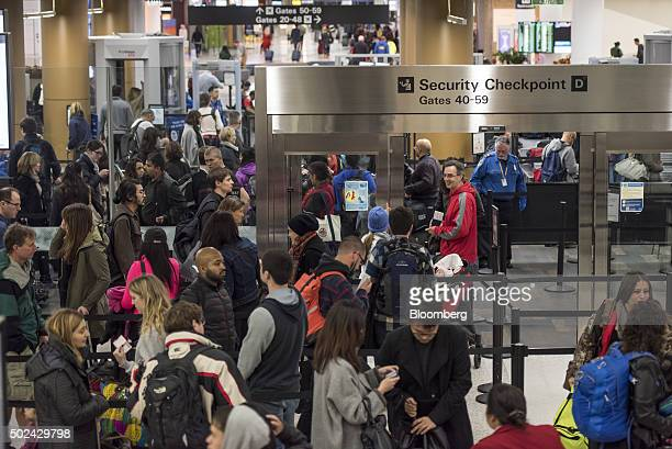 Travelers go through the security checkpoint at San Francisco International Airport in San Francisco California US on Thursday Dec 24 2015 US...