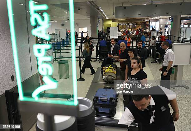 Travelers go through the TSA Precheck line at Miami International Airport on June 2 2016 in Miami Florida As the busy summer travel season heats up...