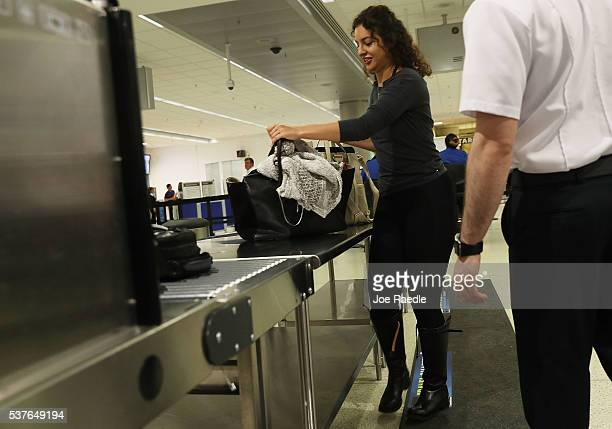 Travelers go through the TSA PreCheck security point at Miami International Airport on June 2 2016 in Miami Florida As the busy summer travel season...