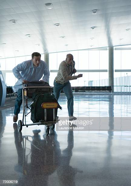 Travelers hurrying though airport