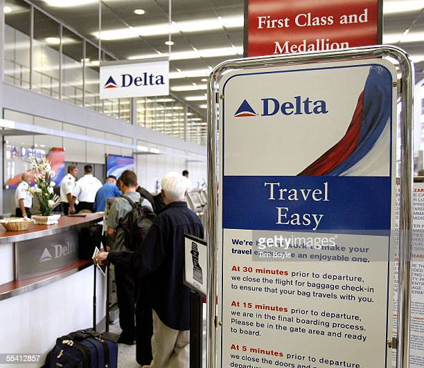 Travelers in line are seen at the ticket counter area of Delta Air Lines inside its terminal at O'Hare International Airport September 14 2005 in...