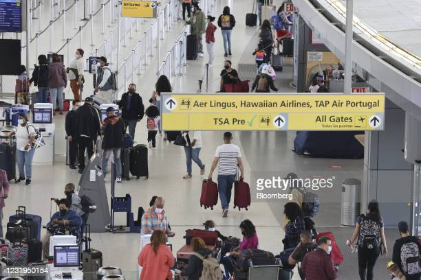 Travelers inside Terminal 5 at John F. Kennedy International Airport in New York, U.S., on Friday, March 26, 2021. The TSA screened more than 1.3...