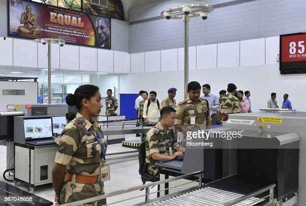 Travelers line up to be screened by security personnel inside the newly inaugurated Terminal 2 building at the Indira Gandhi International Airport in...