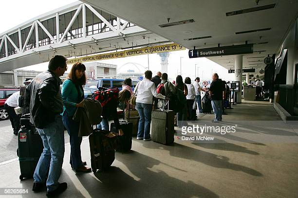 Travelers make their way through Los Angeles International Airport on the eve before Thanksgiving November 23 2005 in Los Angeles California The day...