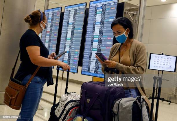 Travelers make their way through the Miami International Airport before starting the Labor Day weekend on September 03, 2021 in Miami, Florida. The...