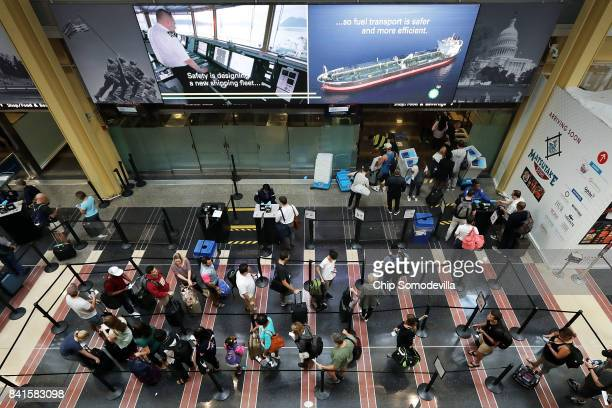 Travelers move through one of the Transportation Security Administration lines at Ronald Reagan National Airport's Terminal B and C September 1 2017...