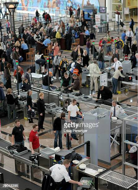 Travelers move through the security line the day before Thanksgiving at the Denver International Airport on November 21 2007 in Denver Colorado Today...