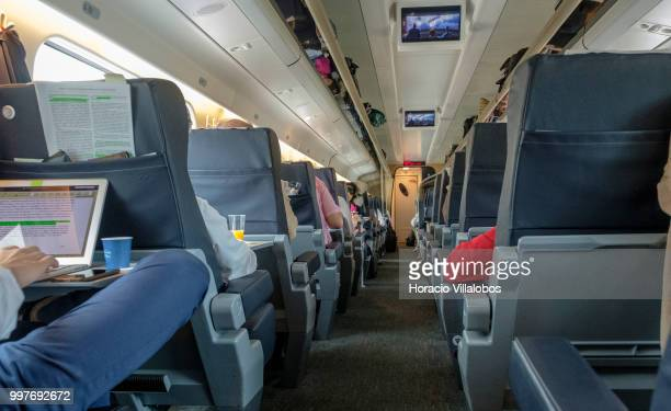 Travelers on board a first class railway car of the high speed Alfa Pendular train during a LisbonPorto journey on July 05 2018 in Porto Portugal...