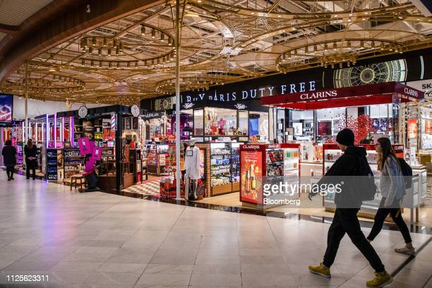 Travelers pass duty free stores at Charles de Gaulle airport operated by Aeroports de Paris in Roissy France on Friday Feb 15 2019 The French Senate...