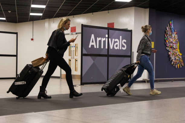GBR: Holiday Makers Return As U.K. Reviews Travel Rules