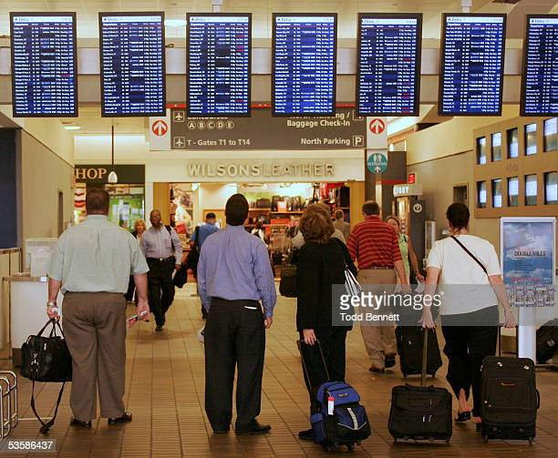 Travelers pause to check flight information before proceeding to their gates at HartsfieldJackson Atlanta International Airport August 31 2005 in...