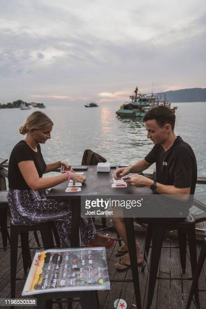 travelers playing cards in southeast asia - kota kinabalu stock pictures, royalty-free photos & images