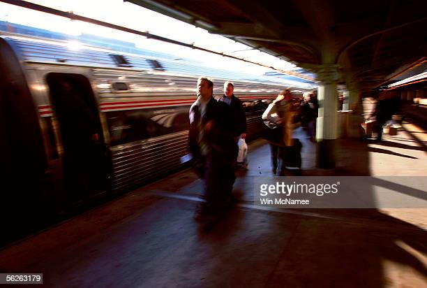 Travelers prepare to board an Amtrak train at Union Station November 23 2005 in Washington DC The day before Thanksgiving is traditionally the...