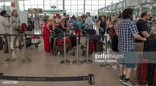 Travelers queue at checkin counters in Terminal 1 of Barcelona El Prat Airport on September 09 2018 in Barcelona Spain Barcelona El Prat Airport an...