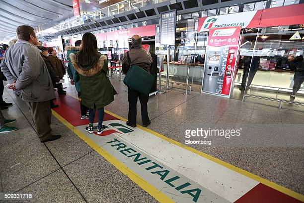 Travelers queue outside Trenitalia SpA's ticket office at Termini train station in Rome Italy on Tuesday Feb 9 2016 The Poste Italiane IPO which...