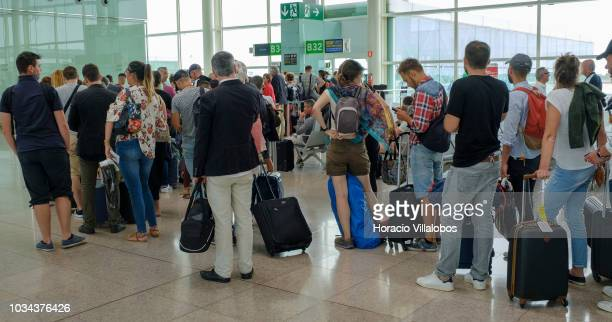 Travelers queue to board a Vueling flight to BrestBretagne in Terminal 1 of Barcelona El Prat Airport on September 09 2018 in Barcelona Spain...