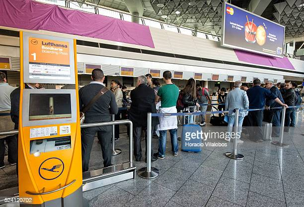 Travelers queue to reschedule flights in the European Union during the first day of Lufthansa pilots' strike in Terminal 1 at Frankfurt International...